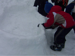 Children building snow fort